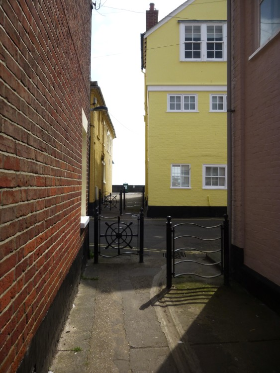 I stood outside the side door to take this - the beach is just over the little wall at the end of Neptune Passage
