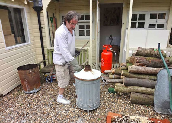 Rob raku firing outside his studio